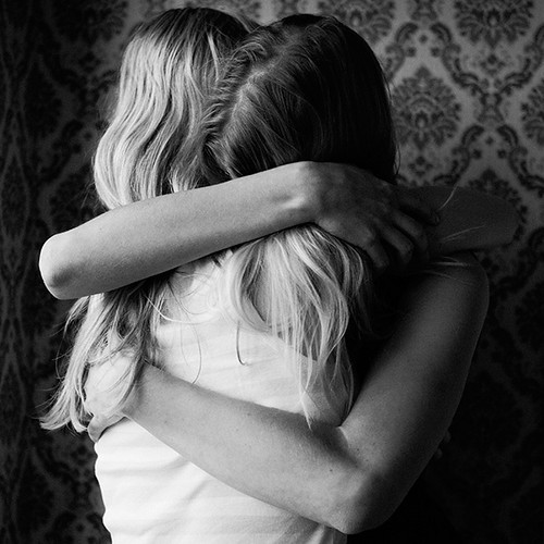 women-hugging